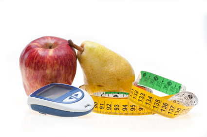 Apple, pear, tape and glucometer